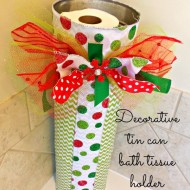 Decorative tin can bath tissue holder