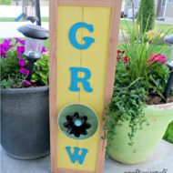 Summertime Grow flower sign using dishes