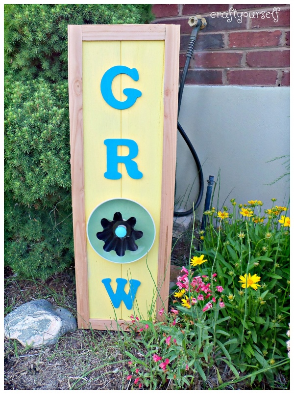 Summertime Grow flower sign using dishes displayed