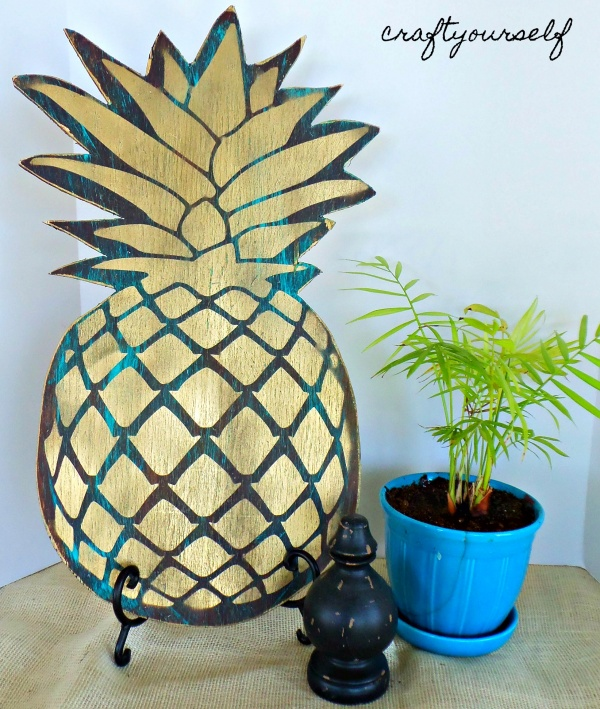 antiqued pineapple decor