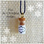 mini jar of snowflakes necklace